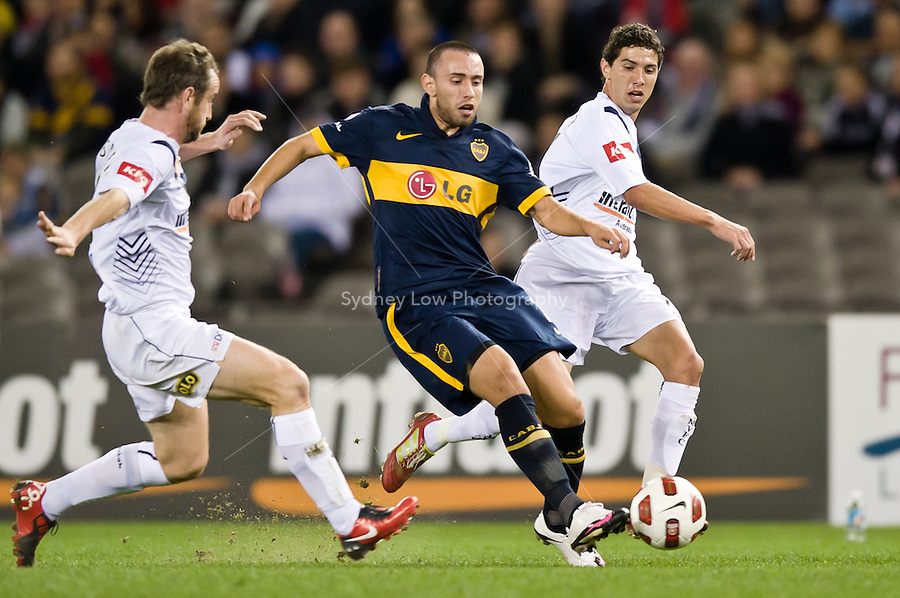 MELBOURNE, AUSTRALIA - JULY 16, 2010: Marcelo Canete from Boca Juniors runs with the ball in a friendly match between the Melbourne Victory and Boca Juniors at Etihad Stadium on July 16, 2010 in Melbourne, Australia. Photo Sydney Low / www.syd-low.com