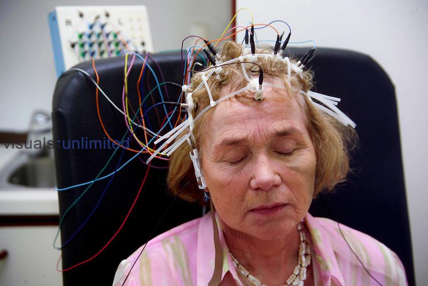 Patient with EEG equipment