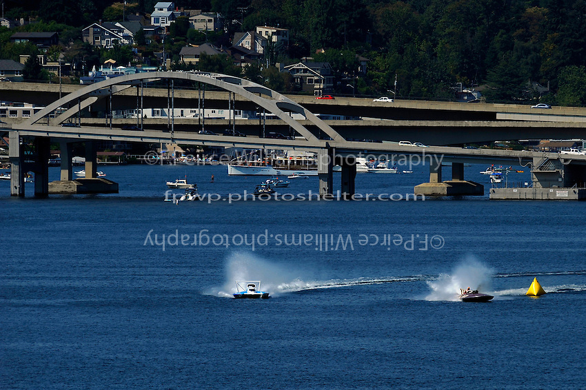 "Chip Hanuauer, U-787 ""Boeing"" (powered by the ""green"" bio fuel Camelina) and Larry Fuller, U-77 ""Miss Wahoo"" (Replica of the vintage 1956 hull built in 2009)...1-2 August, 2009 Seattle, Washington USA..©2009 F.Peirce Williams USA.."