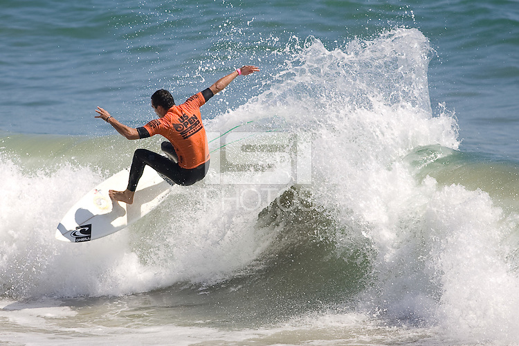 Hawaiian Roy Powers smacks the lip of an inside section during round of 96 at the 2010 US Open of Surfing in Huntington Beach, California on August 4, 2010.