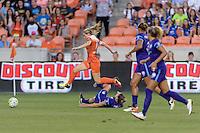 Houston, TX - Friday May 20, 2016: Houston Dash forward Kealia Ohai (7) hurdles Orlando Pride defender Stephanie Catley (7) during a regular season National Women's Soccer League (NWSL) match at BBVA Compass Stadium.