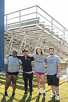 From left: Senior Tonnekqua Dixon, 17, freshmn Richard Perez, 14, and Zoe White, 14, and senior Austin Overstreet, 16, (ALL CQ) pose together after a Peer Group Connection field day where freshmen students meet their senior mentors at Greene Central Central High School in Snow Hill, NC Friday, September 22, 2017. (Justin Cook for Education Week)