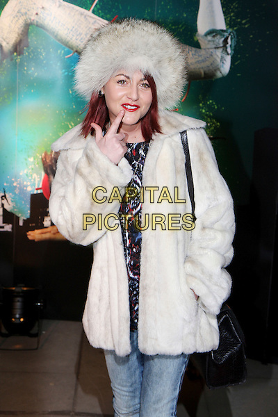 "JAIME WINSTONE.VIP Gala Premiere of Cirque de Soleil - ""Quidam"" at the Royal Albert Hall, London, England. .January 6th 2009 .half length Jamie white grey gray fur hat jacket coat blue print top jeans hand in pocket finger pointing red lipstick .CAP/MAR.© Martin Harris/Capital Pictures."