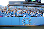 "30 August 2014: UNC fans spell out ""Smart Fast Physical"" on their chests. The University of North Carolina Tar Heels hosted the Liberty University Flames at Kenan Memorial Stadium in Chapel Hill, North Carolina in a 2014 NCAA Division I College Football game."