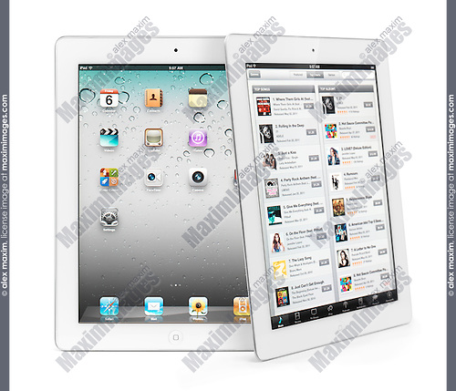 Two white Apple iPad 2 tablet computers. Isolated on white background.