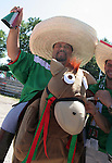 """11 June 2006: A Mexico fan """"rides"""" into the game in his horse suit. Mexico played Iran at the Frankenstadion in Nuremberg, Germany in match 7, a Group D first round game, of the 2006 FIFA World Cup."""