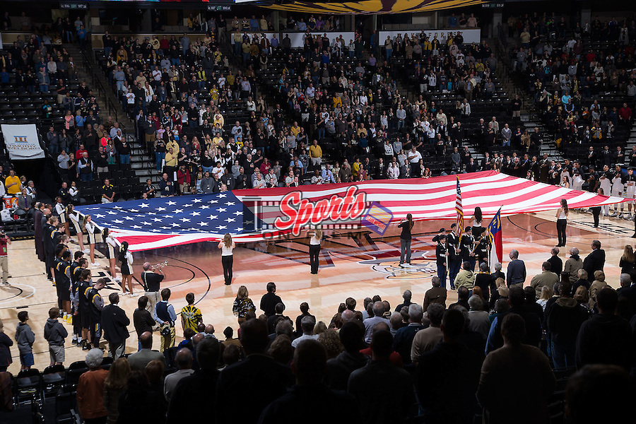 A giant American flag is displayed on the court during the National Anthem prior to the NCAA men's basketball game between the UMBC Retrievers and the Wake Forest Demon Deacons at the LJVM Coliseum on November 13, 2015 in Winston-Salem, North Carolina.  (Brian Westerholt/Sports On Film)