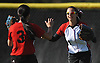 Kylie Marlow #4, Syosset centerfielder, gets congratulated by shortstop Jessica Hom #3 after making a diving catch to end the top of the fourth inning of a non-league varsity softball game against Seaford at Syosset High School on Wednesday, Apr. 27, 2016. Syosset won by a score of 4-3.
