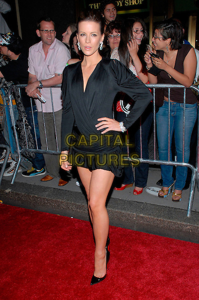 "KATE BECKINSALE.US Premiere of ""Live Free or Die Hard"" held at Radio City Music Hall, New York City, New York, USA, .22 June 2007..full length black ruched mini wrap dress hand on hip dress 4.0 Christian Louboutin shoes stilettoes.CAP/ADM/BL.©Bill Lyons/AdMedia/Capital Pictures. *** Local Caption ***"