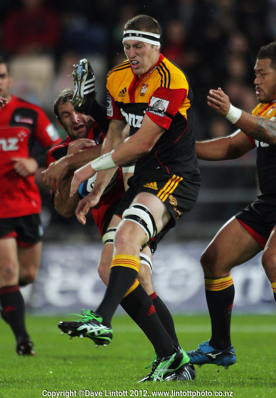 George Whitelock (left) and Brodie Retallick compete for the ball during the Super 15 rugby union match between Crusaders v Chiefs at McLean Park, Napier, New Zealand on Friday, 9 March 2012. Photo: Dave Lintott / lintottphoto.co.nz