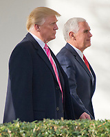 United States President Donald J. Trump and US Vice President Mike engage in a discussion as they walk along the Colonnade of the White House in Washington, DC prior to the President's departure for Mar-A-Lago, where he will spend the Thanksgiving holiday, on Tuesday, November 21, 2017.<br /> Credit: Ron Sachs / CNP /MediaPunch NortePhoto.com