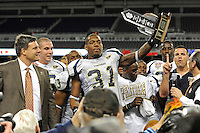 26 December 2010:  FIU linebacker Jarvis Wilson (31) is awarded the trophy for defensive player of the game after the FIU Golden Panthers defeated the University of Toledo Rockets, 34-32, to win the 2010 Little Caesars Pizza Bowl at Ford Field in Detroit, Michigan.