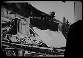 RGS plow-flanger #02 with snow on plow.  Leased D&amp;RGW #461 pushing it across Bridge 45-B northbound at Ophir.<br /> RGS  Ophir, CO  Taken by Reid, Homer - ca. 1946