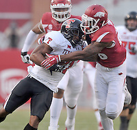 NWA Democrat-Gazette/MICHAEL WOODS • @NWAMICHAELW<br /> Texas Tech running back DeAndre Washington is tackled by Arkansas defender Rohan Gaines after a big run in the 1st quarter of Saturday nights game at Razorback Stadium in Fayetteville.