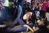 An injured video journalist is seen shortly before the police lost control of Mong Kok ceding it back to the protesters, who had only just lost it to the police hours earlier in a pre-dawn raid, Mong Kok, Kowloon, Hong Kong, China, 18 October 2014.