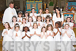 Pupils from 2nd class presentation primary school who made their First Holy Communion on Saturday in St John's church Tralee, with their teacher Ms Noreen Foley and Fr Kieran O'Brien.   Copyright Kerry's Eye 2008