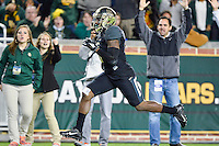 Fans react as Baylor wide receiver Antwan Goodley (5) rushes for a touchdown during second half of an NCAA football game, Saturday, December 06, 2014 in Waco, Tex. Baylor defeated Kansas State 38-27. (Mo Khursheed/TFV Media via AP Images)
