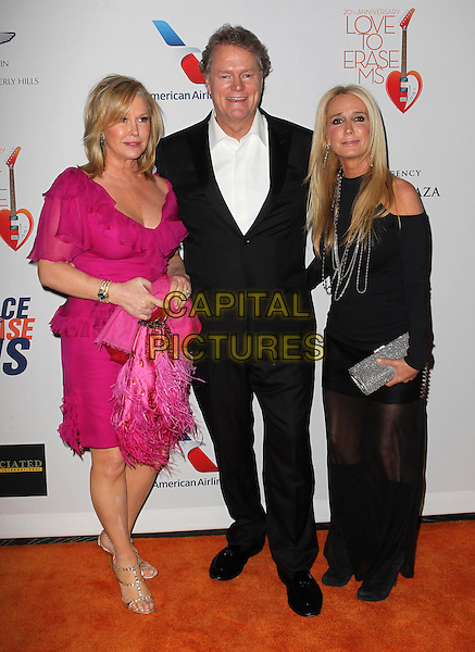 Kathy Hilton, Rick Hilton, Kim Richards.20th Annual Race To Erase MS Gala held at the Hyatt Regency Century Plaza Hotel, Century City, California, USA, 3rd May 2013..full length pink dress ruffles white shirt black suit husband wife sister siblings family couple sheer long maxi leather skirt feather bag .CAP/ADM/KB.©Kevan Brooks/AdMedia/Capital Pictures