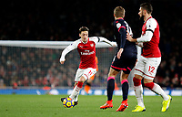 Mesut Ozil of Arsenal on the ball during the Premier League match between Arsenal and Huddersfield Town at the Emirates Stadium, London, England on 29 November 2017. Photo by Carlton Myrie / PRiME Media Images.