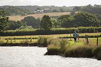 20 JUL 2008 - MANLEY, UK - Kelly Crickmore goes for a pre race warmup - Deva Divas Triathlon. (PHOTO (C) NIGEL FARROW)
