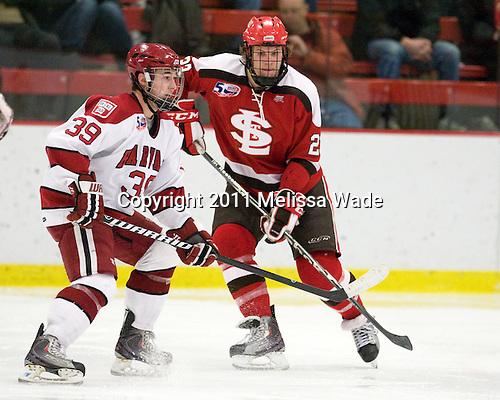 Pier-Olivier Michaud (Harvard - 39), Riley Austin (St. Lawrence - 23) - The Harvard University Crimson defeated the St. Lawrence University Saints 4-3 on senior night Saturday, February 26, 2011, at Bright Hockey Center in Cambridge, Massachusetts.