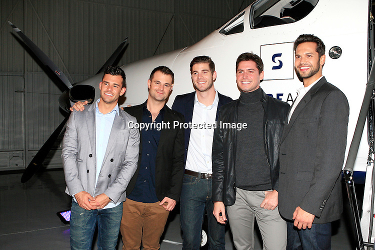 LOS ANGELES - DEC 18: Surfair and Tesla Holiday Party at a Private Hangar on December 18, 2014 in Hawthorne, California