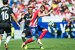 Yannick Ferreira Carrasco (r) of Atletico de Madrid competes for the ball with Gabriel Ivan Mercado of Sevilla FC during the La Liga 2017-18 match between Atletico de Madrid and Sevilla FC at the Wanda Metropolitano on 23 September 2017 in Wanda Metropolitano, Madrid, Spain. Photo by Diego Gonzalez / Power Sport Images
