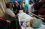 Palestinian prime minister Rami Hamdallah visits patients at Gaza City's Al-Shifa hospital on October 5, 2017. For three days it was all smiles as the Palestinian prime minister held talks in Gaza with Hamas but as the symbolic visit draws to a close the real work for reconciliation is just beginning. Photo by Mohammed Asad