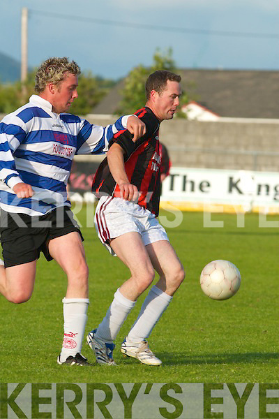 A nudge in the.right direction..Castlegregor y.midfielder Fergal.Murphy leans on.AC Athletic's.David O'Connor.in their drawn.cup game at.M o u n t h a w k.Park.