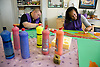 Day Service users with learning disabilities using sponge shapes to paint,