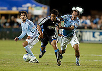 Quincy Amarikwa (25) drives through Mehdl Ballouchy (8) and Nick LaBrocca (22). San Jose Earthquakes tied the Colorado Rapids 1-1 at Buck Shaw Stadium in Santa Clara, California on September 18, 2009.