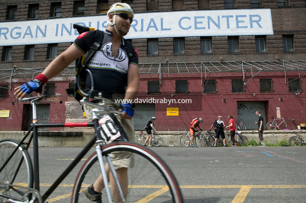 3 July 2005 - Jersey City, NJ, USA - Riders stop at a checkpoint in the final race of the 13th annual cycle messenger world championships, Jersey City, USA, July 2nd 2005. More than 700 riders from all over the world took part in the 4-day competition which carries event based on the daily work of a city bike messenger.