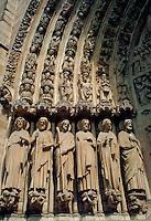 Ornate carved figures on doorway of Notre Dame cathedral, Paris, France