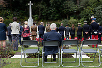 An older man takes a seat during the service at the Remembrance Sunday ceremony at the Hodogaya, Commonwealth War Graves Cemetery in Hodogaya, Yokohama, Kanagawa, Japan. Sunday November 11th 2018. The Hodagaya Cemetery holds the remains of more than 1500 servicemen and women, from the Commonwealth but also from Holland and the United States, who died as prisoners of war or during the Allied occupation of Japan. Each year officials from the British and Commonwealth embassies, the British Legion and the British Chamber of Commerce honour the dead at a ceremony in this beautiful cemetery. The year 2018 marks the centenary of the end of the First World War in 1918.