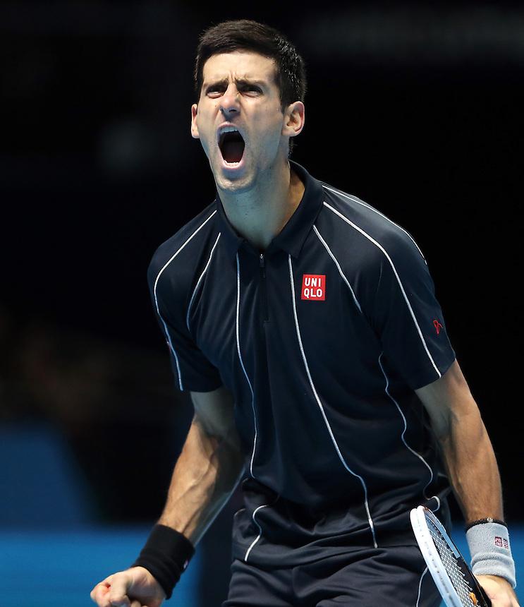 Semi-Final - Novak Djokavic (SER) celebrates a break in serve against Stanislas Wawrinka (SWZ)<br /> <br /> Photo by Rob Newell/CameraSport<br /> <br /> International Tennis - Barclays ATP World Tour Finals - O2 Arena - London - Day 7 -  Sunday 10th November 2013<br /> <br /> &copy; CameraSport - 43 Linden Ave. Countesthorpe. Leicester. England. LE8 5PG - Tel: +44 (0) 116 277 4147 - admin@camerasport.com - www.camerasport.com