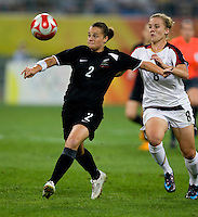 Amy Rodriguez, Ria Percival. The USWNT defeated New Zealand, 4-0, during the 2008 Beijing Olympics in Shenyang, China.  With the win, the USWNT won group G and advanced to the semifinals.