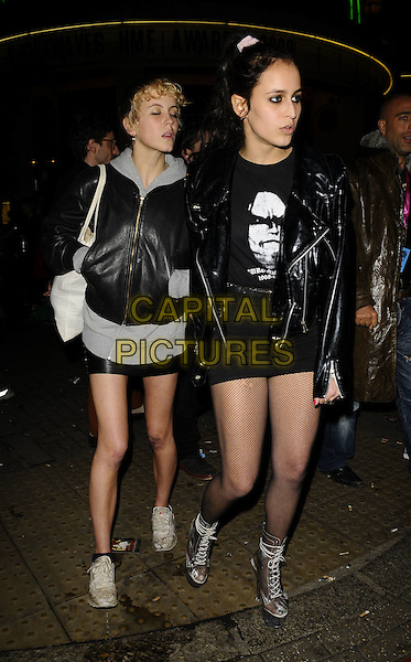 GUEST & ALICE DELLAL.The NME Music Awards 2009, O2 Brixton Academy, Brixton, London, England..February 25th, 2009.full length black leather jacket fishnet stockings silver platform heels shoes sneakers trainers grey gray skirt.CAP/CAN.©Can Nguyen/Capital Pictures.