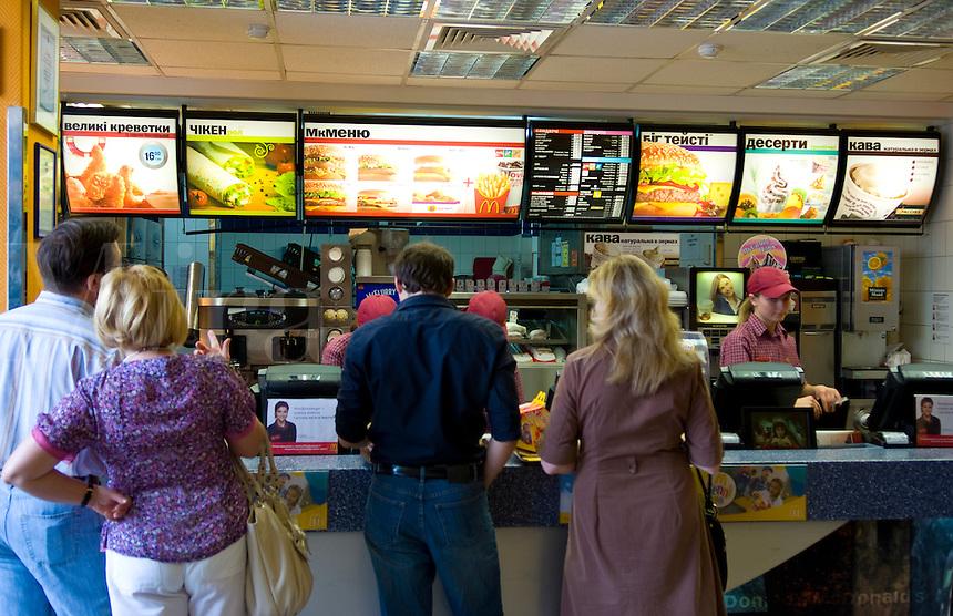Modern city Ukraine McDonalds with customers in line in downtown Kiev Ukraine