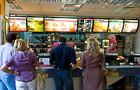 Modern city Ukraine McDonalds with customers in line in downtown Kiev Ukraine
