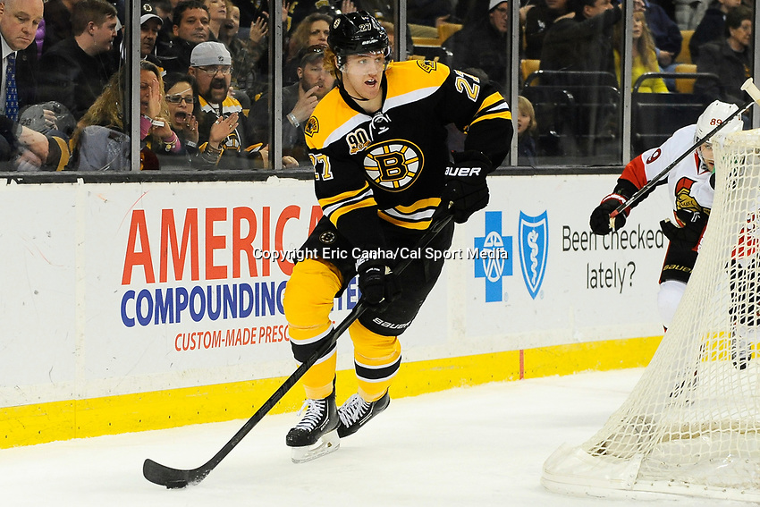 February 8, 2014 - Boston, Massachusetts, U.S. - Boston Bruins defenseman Dougie Hamilton (27) in game action during the NHL game between the Ottawa Senators and the Boston Bruins held at TD Garden in Boston Massachusetts. The Bruins defeated the Senators 7-2 in regulation time.  Eric Canha/CSM