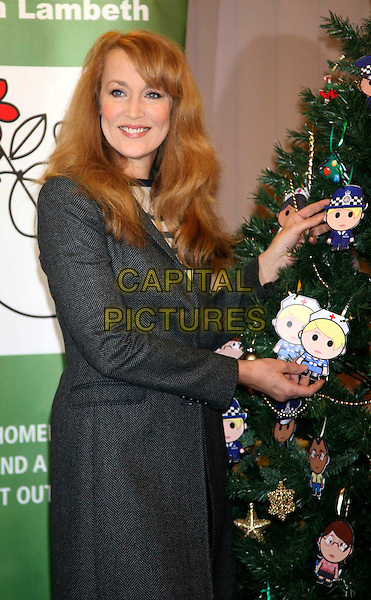JERRY HALL.Decorates homeless charity's Christmas tree at Emmaus South Lambeth, London, England..November 18th, 2008.half length black jacket white striped stripes grey gray coat  .CAP/DS.©Dudley Smith/Capital Pictures
