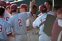 STOCKTON, CA - May 9, 2011: Brian Ragira of Stanford baseball gets a pat on the head after hitting a three run homerun during Stanford's game against Pacific at Klein Family Field in Stockton. Stanford won 11-5.