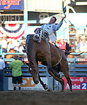 Zack Curran competes in the bareback bronc riding event at the Reno Rodeo in Reno, Nev., on Thursday, June 27, 2013.<br /> Photo by Cathleen Allison