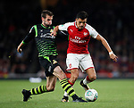 Arsenal's Alexis Sanchez tussles with Doncaster's Matty Blair during the Carabao Cup Third Round match at the Emirates Stadium, London. Picture date 20th September 2017. Picture credit should read: David Klein/Sportimage