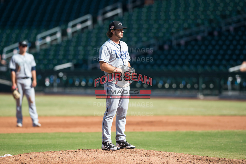 Peoria Javelinas relief pitcher Phoenix Sanders (52), of the Tampa Bay Rays organization, prepares to deliver a pitch during an Arizona Fall League game against the Mesa Solar Sox at Sloan Park on October 24, 2018 in Mesa, Arizona. Mesa defeated Peoria 4-3. (Zachary Lucy/Four Seam Images)