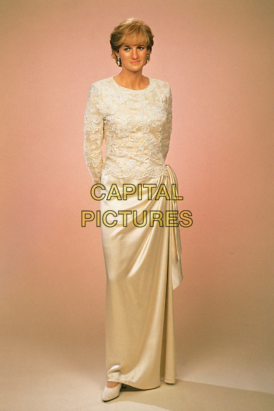 HRH, THE PRINCESS DIANA OF WALES WAXWORK.Madame Tussards Waxwork Museum, London, England..Lady Di family her royal highness full length cream white beaded top dress gown skirt silk satin ruched gathered at the side.CAP/PLF.Supplied by Capital Pictures