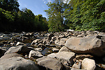 Rocks and stones on the river bed, fast moving stream, Aysgarth falls North Yorkshire,England