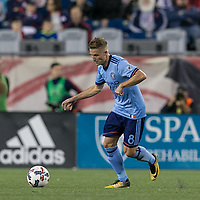Foxborough, Massachusetts - October 15, 2017: In a Major League Soccer (MLS) match, New England Revolution (blue/white) defeated New York City FC (light blue/blue), 2-1, at Gillette Stadium.