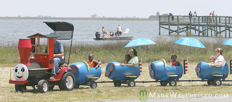 Festival patrons enjoyed spending the day at Woolley Park including those riding the Party Train, made from a law tractor and six barrels,during the 33rd Annual Panacea Blue Crab Festival at Woolley Park in Panacea, Florida May 5, 2007.  Festival attendees enjoyed fresh local blue crabs and entertainment by Mountain Dew Cloggers, Grant Peeples and King Cotton in addition to the annual mullet toss and crab picking contests.  (Mark Wallheiser/TallahasseeStock.com)