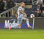 Johnny Russell of Sporting KC leaps and kicks the ball. Sporting KC defeated Club Atletico Independiente 3-0 in a CONCACAF Champions League quarterfinal game at Children's Mercy Park on March 14, 2019.